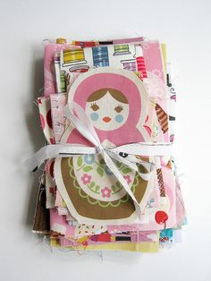 Stack of novelty fabric scraps.