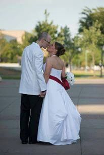 """Marc Tissot ('03 '05) and Stacey ('06) enjoying a """"newlywed"""" stroll near the Student Union"""