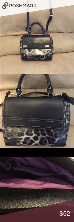 Nine West bag.  NWOT Beautiful animal print bag with two sides of pockets with excellent snap closures.  Wear using handle, shoulder or long shoulder strap as a crossbody.  Re-posh bag, bought brand new with tags and used once just wasn't right fit!  Also has metal feet on bottom to protect bag.  10 in wide by 8 in tall.  Smoke free home. Bags Crossbody Bags