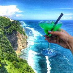 Cheers to the weekend in Bali  @theedgebali  @ashleylokelanie #gopro #tourist #bali #sun #travel #beautifulmemories #indonesia #igers #travelingram #travelling #beach #sea #travelporn #beautiful #summer #love #beauty #nature #tree #sunshine #mothernature #thebalibible #cocktail #theedgebali #AshleyEscape #sunrise #blue #skylovers #clouds by thebalibible