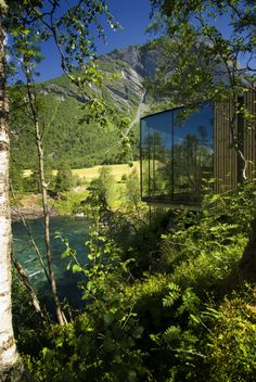 The Juvet Landscape Hotel in Valldal, Norway, is a unique group of 28 individual glass cabins nestled along a nature reserve that otherwise is prohibited f