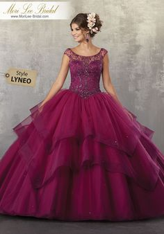 Style LYNEO Crystal Beaded Bodice on a Flounced Tulle Ballgown Fresh and Feminine, This Tulle Quinceañera Dress Features a Beautiful Illusion Off the Shoulder Neckline. Delicate Beading and Horsehair Trim Accent the Skirt. Matching Stole Included. Colors Available: Coral, Navy, Black Cherry, White