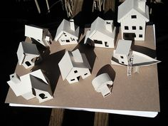 """I have wanted to make some glitter houses since my friend gave me an ornament with a tiny glittered house inside a few years ago. I found out they are a pretty popular old fashioned decoration for the holidays, the more substantial old ones are called """"Putz Houses"""". I found some helpful templates online (linked below) for several different styles."""