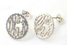 Our Scallop Filigree Silver Monogram Earrings  feature your monogram engraved in the font you choose.