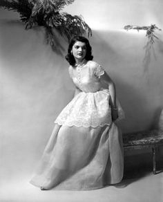 .Very young Jackie...so adorable in a tiered,  scalloped formal dress.