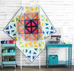 Brighten up any room with this simple, yet striking quilt. Our exclusive pattern and fabric are all you need to sew your own.