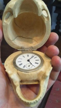 Ivory memento mori  with pocket watch movement