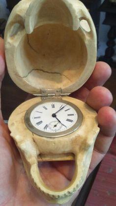 Ivory memento mori  with pocket watch movement