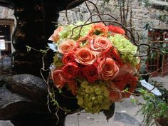 Green Hydrangea, orange roses & curly willow