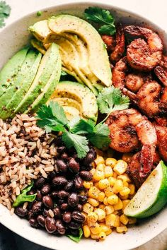 Blackened Shrimp Avocado Burrito Bowls are the perfect way to ring in the New Year with big bold flavor and a healthy meal! Blackened Shrimp Avocado Burrito Bowls are the perfect way to ring in the New Year with big bold flavor and a healthy meal! Seafood Recipes, Mexican Food Recipes, Vegetarian Recipes, Cooking Recipes, Healthy Recipes, Sausage Recipes, Pasta Recipes, Pescatarian Recipes, Rice Recipes