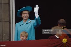 Queen Elizabeth II with Prince Harry (left) and Prince William on the balcony at Buckingham Palace for Trooping The Colour, 11th July 1988.