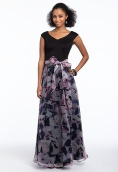 This classic silhouette is the perfect pick for a springtime wedding! The modest capped sleeves, V-neckline, fitted jersey bodice and floral chiffon A-line skirt on this wedding guest dress are a fitting choice for an indoor or outdoor ceremony. Finish off your look with ankle strap sandals and an all satin banded clutch. #CamilleLaVie