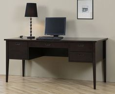 This tasteful writing desk improves the look of any area in the home or office. This large desk features a Halifax brown finish to match with any existing color scheme. The desk includes a left file drawer, center and right storage drawers.