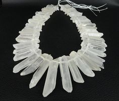 $9.80 half strand50pcs/strand of Natural Raw White Crystal Quartz Top Drilled Graduated Beads ,AA-Grade Quality Clear Rock Crystal Pendant Bead 5-12X30-40mm