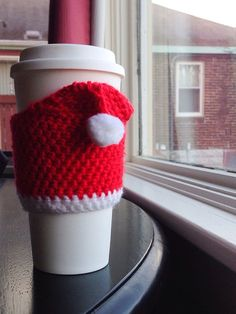 Knit (this is crochet) Santa hat cup sleeve.