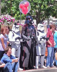 I thought Darth Vader with a Disney balloon was funny enough...and then I saw what the stormtroopers have on...I love it!