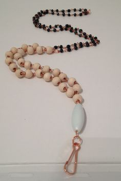 """Color: Blue and WhiteMaterials: Copper Wire, glass beads, ceramic bead, wooden beads Length: 38"""" aroundThis lanyard can transform into an E"""