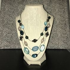 Teal and silver necklace Very cute and sophisticated necklace. Great work piece. Teal, black and silver beads. Silver chain Jewelry Necklaces