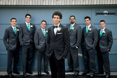 Markham Wedding Photography, groomsmen hanging out outside the house, in front of the garage, blue wall, blue garage.