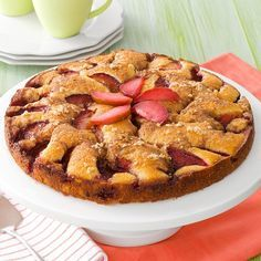 Fresh Plum Kuchen Recipe -In late summer when plums are in season, this tender fruit-topped cake is delectable! The plum slices look so appealing arranged in circles on top. For variety, I sometimes substitute fresh pear or apple slices instead. —Anna Daley, Montague, Prince Edward Island