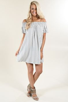 Black and ivory pin stripe off the shoulder dress. Elastic bust - lots of stretch. Pair it with a black belt to add a bit of hourglass shape to it! Fit: True to size with a looser fit. Material: 80% R