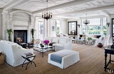 floor to ceiling fireplace, white washed walls, and ceiling, in love with this living room, and all the light!