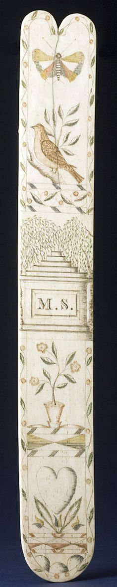 "1801 - 1900    Scrimshaw busk with polychrome decoration, initialed ""M.S."", of typical form, engraved with butterfly, dove on a branch, memorial surrounded by willows, potted flowers and a heart, all within a leaf and vine border."