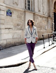 White blazer with wide sky blue piping accents, amethyst cropped cigarette trousers, and metal t-strap heel