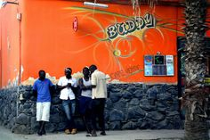 African guys hanging out in Santa Maria, Sal, Cape Verde.