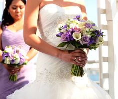 Lavender and white wedding bouquets with calla lilies, freesia, stock and Ocean Song roses.