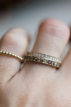 The Small Pea Pod Ring features and array of pretty diamonds all in a perfect row - what's not to love? This channel set eternity band can easily be added to a wedding stack and plays well with any other jewelry you're currently wearing. Customize yours with white diamond, champagne diamond, gray diamond or black diamond and with or without milgrain. Paired here with the slightly larger Pea Pod Ring.