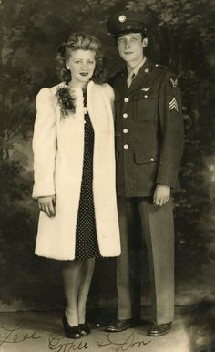 1940s couple - I  like that her hair isn't done up in your average 1940's hairstyle.