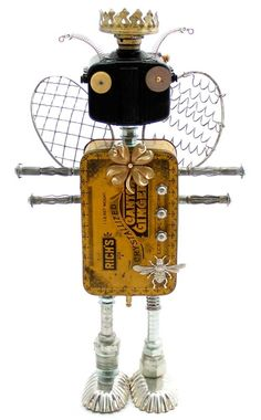 """Bee-Bop-A-Lula""   Height: 16""   Principal Components: Baby Brownie camera, candied ginger tin, oil lamp part, whisks, expansion bolts, jewelry, hose fittings, tartlet tins, clock gear"