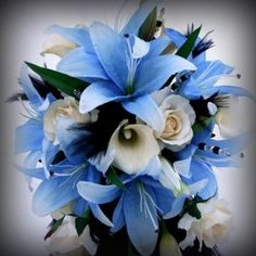 A very cool bouquet! Love the calla lilies, roses, and other lily (star?) combo with some greens Very pretty!!