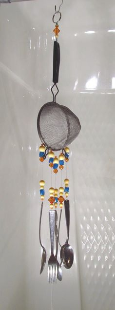 Wind Chime - Kitchen Wind Chime - Vintage Strainer Wind Chime - No Strain Here- Handmade by passingtimeandchimes on Etsy. $18.00, via Etsy.