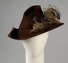 Hat  Sally Victor  (American, 1905–1977)    Date:      1940  Culture:      American  Medium:      Wool, hair, feathers  Credit Line:      Brooklyn Museum Costume Collection at The Metropolitan Museum of Art, Gift of the Brooklyn Museum, 2009; Gift of Sally Victor, Inc., 1944  Accession Number:      2009.300.4457