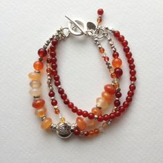 Carnelian and Hill Tribe Sterling Silver Triple Strand Bracelet Strand Bracelet, Gemstone Bracelets, Handmade Bracelets, Handcrafted Jewelry, Gemstone Jewelry, Jewelry Bracelets, Necklaces, Wire Jewelry, Jewelry Crafts