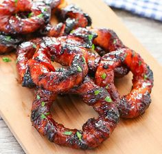 These onion rings are wrapped in bacon that have been dipped in a sriracha glaze. Perfect for a party appetizer! YIELD: 10 PREP TIME: 30 m