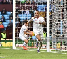 Nathaniel Clyne of Liverpool celebrates after scoring during the Barclays Premier League match between Aston Villa and Liverpool at Villa Park on February 14, 2016 in Birmingham, England.