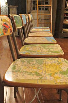 Vintage school chairs covered ever so smoothly in old maps!  Created in Anthropologie style by the incredible  myatleredstate.co
