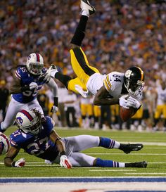Stephon Gilmore Antonio Brown #84 of the Pittsburgh Steelers is hit by Stephon Gilmore #27 of the Buffalo Bills the first half against the B...