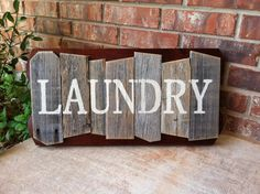 Rustic Random Cedar Wood Sign, Laundry by Weathered Ways - $25.00 » This charming laundry sign is hand-painted and artfully put together. I love its look