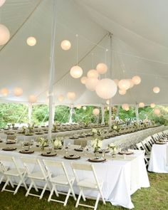Spherical lights threaded throughout a tent created the atmosphere at this backyard wedding in Atlanta, Georgia.