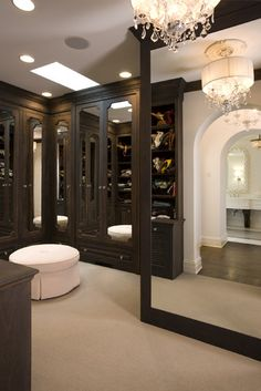 Beautiful Master Wardrobe closet - instead of a door, you enter the open closet through an arch, reflected in the HUGE full-length mirror...