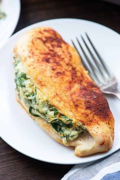 Spinach stuffed chicken breasts are low carb and so easy to make! This healthy chicken recipe takes about 10 minutes to prepare and just 25 minutes to bake. You'll love this cheesy chicken recipe!