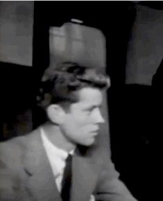 """1939. 22 year old JFK addresses the surviving crew and passengers of the """"SS Athenia"""" on behalf of his father - his first public address"""
