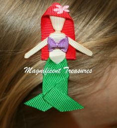Ariel Hair Clip - Little Mermaid Hair Bow - Ribbon Sculpture Ariel from The Little Mermaid is about 2.5-3 inches tall and made completely of ribbon. The clip runs up her back to provide stability and so she can be worn on either side of the head. If you would prefer her on a horizontal clip please leave a note to seller at checkout. She comes on a partially lined single prong alligator clip, a double prong alligator clip, or a pin back. A no slip grip can be added to the alligator clips. All…