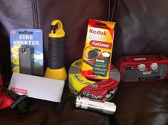 Emergency Supplies - Flashlights, hand crank radio, fire starter, swiss army knife, disposable camera, duct tape