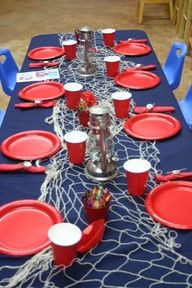 Table at a Nautical Party @Nicole Novembrino White @Laurel Wypkema Johnson I like the netting decoration