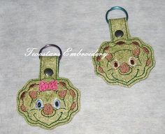 Triceritops key fob girl and boy. by Twostars Embroidery on Zibbet
